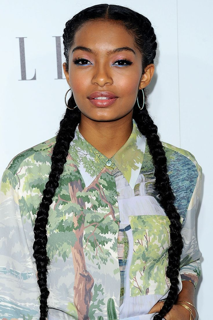 The ante of Yara Shahidi's epic two-tone eyeshadow (pink on the top lids, blue on the bottom) is upped thanks to her double braids, which help to perfectly show off her make-up