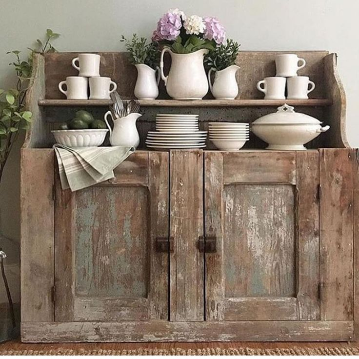 love this Cupboard and antique white dishes