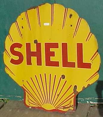 Shell gas station sign, old, worn out. These always captured my attention though with the large sans serif font.