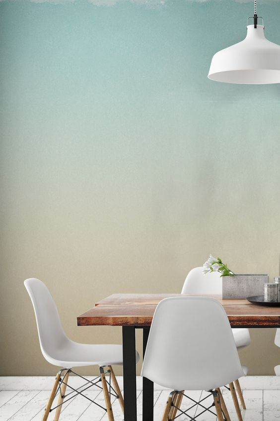 Afraid of painting your walls one block colour? You don't have to take the risk with this beautiful ombre wallpaper design. Sumptuous yet subtle, this design brings together a pastel blue with soft yellow tones. It's perfect for creating a calming atmosphere in your home, and looks stunning in dining room areas.: