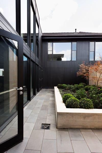 Courtyard and black stained cedar by Lazcon using @porterspaint