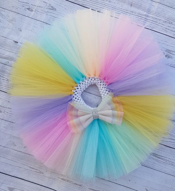 This gourgeous tutu skirt is made with a beautiful mix of pastel colors with a bow carefully made to match to perfection.  This tutu is made with 3 double full layers of the best quality tulle (flame resistant and made in the U.S) . It is very very full and fluffy with over 75y of tulle. It is made in a soft elastic crochet headband so your little one can grow in it and enjoy it for many years to come.  Have a different idea of colors in mind for this tutu skirt? Message me for a custom…
