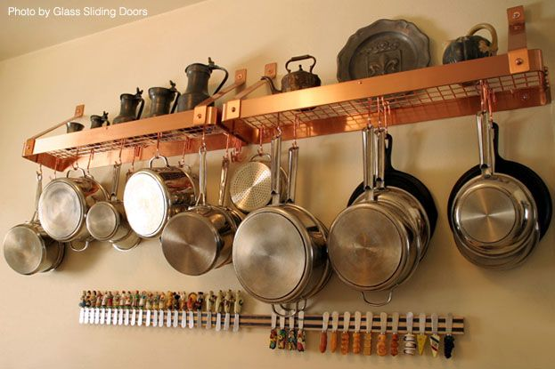 Small Kitchens Rack avoid storing kitchen utensils on the surface..wall mounted rack to hang pots..install a small curtain rod near pot rack to keep lids within reach