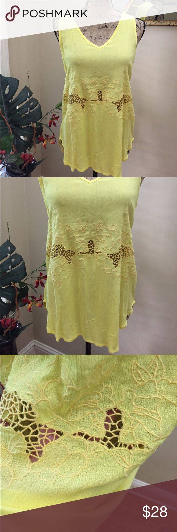 """🌼Boutique hi-lo embroidered cage back tunic! 🌼Boutique NWT yellow embroidered cage back tunic. Bright summery. Happy! It's just stunning. Has a cute cage back with embroidered detail at the midline. NWT. pit to pit measurement is 18"""". Some stretch. Length in front is 25"""". Back is 28"""". boutique Tops Tunics"""