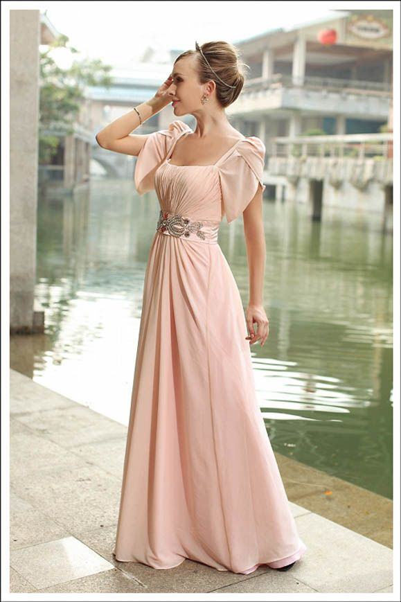 Not your standard eveningwear. But I LOVE this romantic look. I think everything about it screams class.