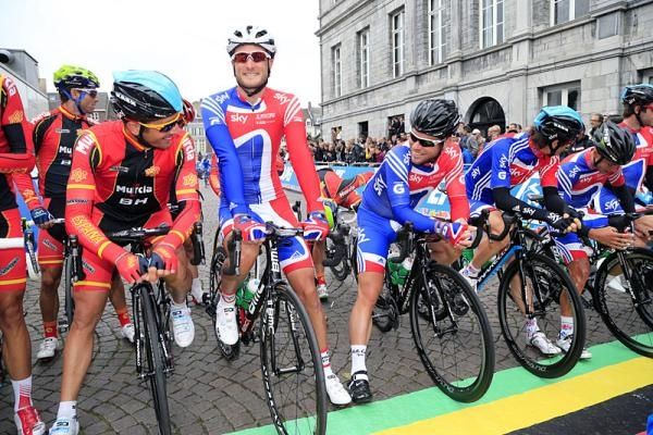Outgoing world champion Mark Cavendish and his Great Britain teammates line up on the front at the start line.