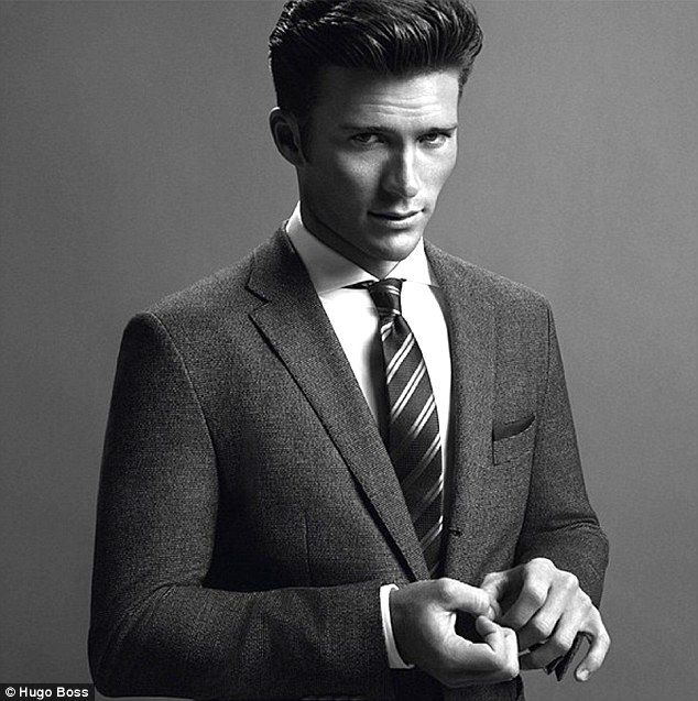Like father, like son: Clint Eastwood's dashing 28-year-old son Scott is the star of a new campaign for Hugo Boss, showcasing his suave looks in three black-and-white photos http://dailym.ai/SsRfP0