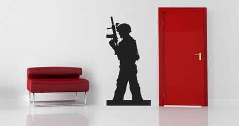 A silhouette of a soldier on duty is featured on this removable wall decal.   Visit this link for more designs: https://limelight-vinyl.myshopify.com/