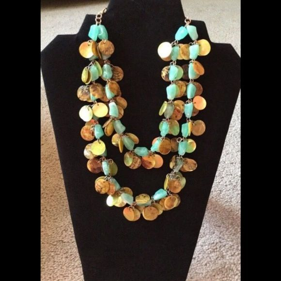 Shell necklace Only Worn once. Made of blue and gold shell. Jewelry Necklaces