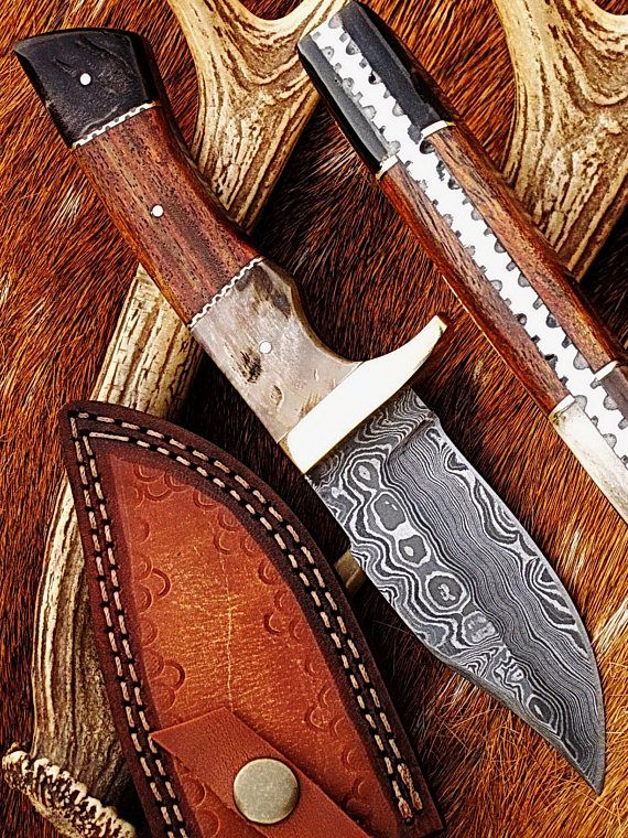 Beautiful hunting knife designed with handsome handle(i.e. the combination of  Rose-wood and Ram-Horn Bolsters). The hardness of the Damascus steel is 55-58 HRC on Rockwell scale. FEATURES & SPECIFICATIONS:  ~ Total Length: 8 ~ Blade length: 4 ~ Handle Length 4 ~ Blade Material: