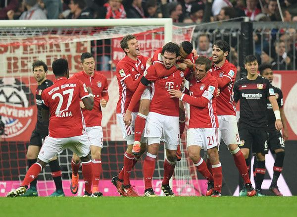 Mats Hummels Photos Photos - Mats Hummels of Muenchen celebrates with his team-mates after scoring his team's second goal during the Bundesliga match between Bayern Muenchen and Bayer 04 Leverkusen at Allianz Arena on November 26, 2016 in Munich, Germany. - Bayern Muenchen v Bayer 04 Leverkusen - Bundesliga