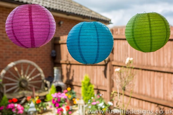 Coloured lanterns look great for weddings and celebrations. www.fuschiadesigns.co.uk