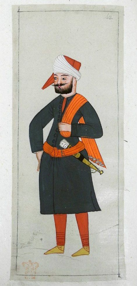 Cezayir. An Algerian or Dardanelles Janissary seaman. Black tunic with a red scarf over his shoulder. Dagger in his red kuşak. White turban with a square red cap and a pointed end.