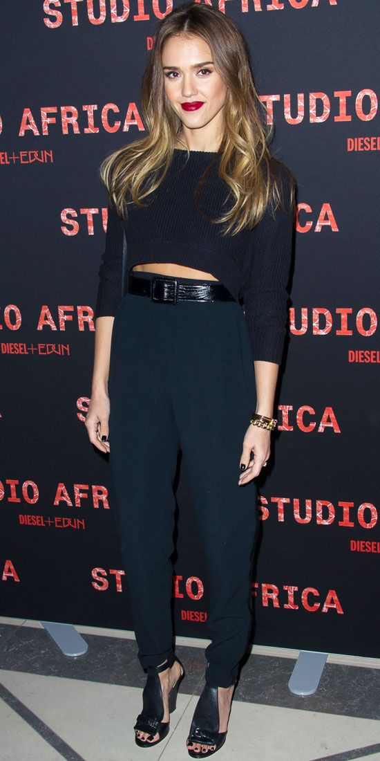 Alba hit a Paris Fashion Week bash in a cropped sweater, belted trousers, leather bag and edgy sandals.