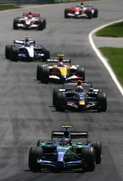 Rubens Barrichello of Brazil and Honda Racing leads David Coulthard of Great Britain and Red Bull Racing during the Canadian Formula One Grand Prix...