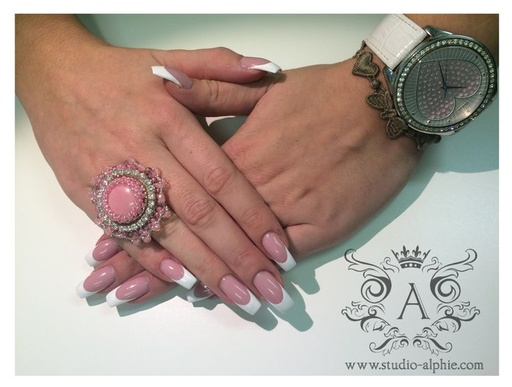 Classic extreme white french nails.