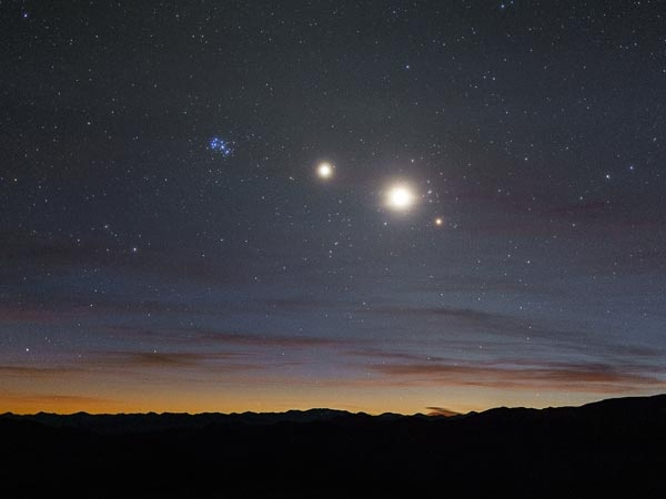 Stellar Line up - The blue star cluster to the left is the Pleiades, also known as the Seven Sisters. Second from left is Jupiter, followed by Venus and the star Aldebaran. - Pictured over Chile's Atacama desert,