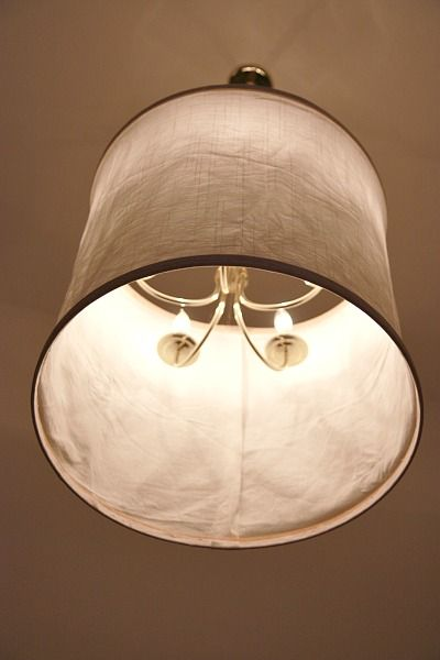 DIY shade made with fabric and emb. hoops; hung over the existing chandy...nice!