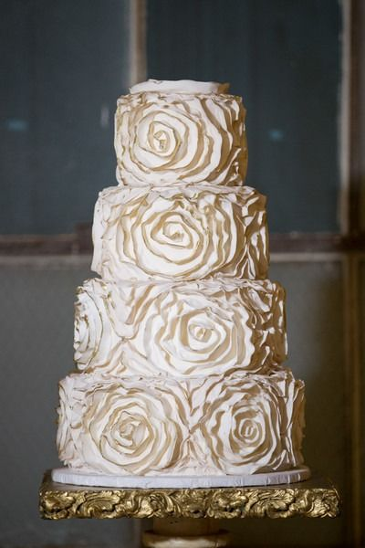 Gold wedding cake - four-tier wedding cake with textured rosettes trimmed with gold {Tracy Autem & Lightly Photography}