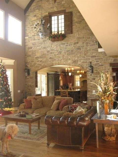 Love the stone accent wall...normally I'd say it's just too much or that it's heavy, but this is a very open, airy feel