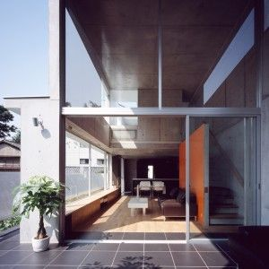 Concrete+home+by+Takuro+Yamamoto+Architects+overlooks+an+allotment+and+woods+near+Tokyo