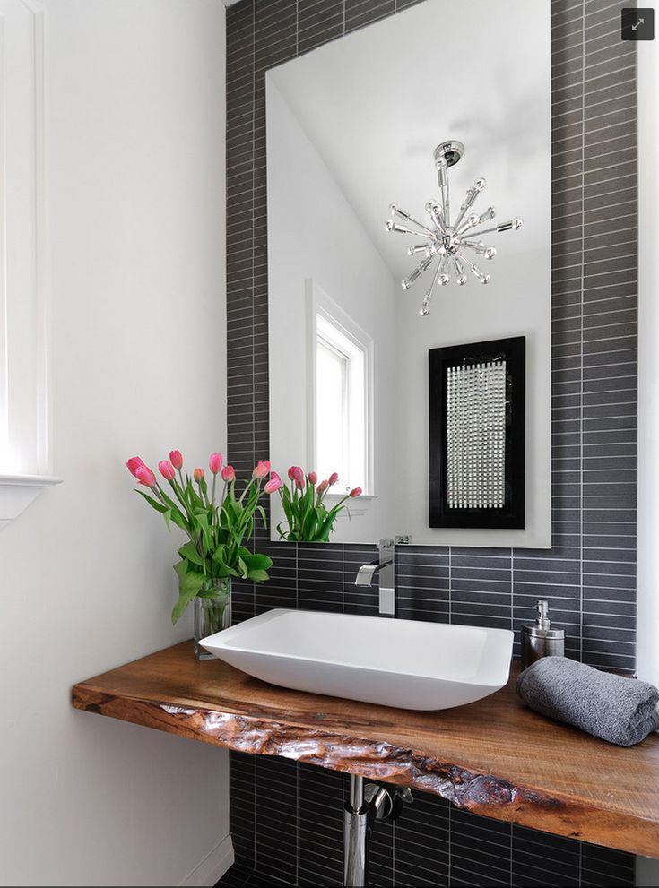 Absolutely love the wooden shelf and modern basin.