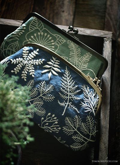 Blue and green embridery pouch . by yumiko higuchi