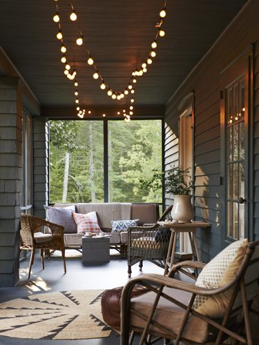 Painting every surface the same deep blue shade of Underwater by Behr transformed the once-choppy porch into an ultra-cozy gathering space.