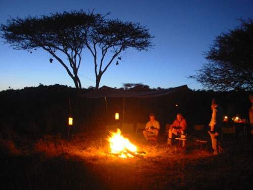 Nothing like an African camp fire. Talk about the wildlife you saw.