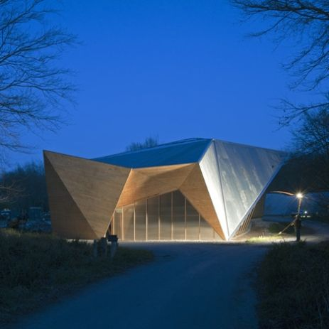 """Architecture: Hooke Park Big Shed by AA Design & Make: """"..Students from London'sArchitectural Associationhave designed and built a faceted wooden workshop in the woods in Dorset, England..owned by the school and will be used as an assembly and prototyping workshop..The larch used to construct the building was sourced both from within the park and from local woodlands..A system of columns and trusses made from unmilled tree trunks comprise the building's structural framework.."""" Distinctive…"""