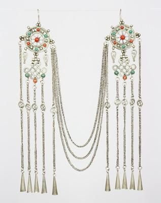 Mongolia  #JW-141  Spectacular and rare Khalkh Mongol silver earrings with coral and turquoise, these feature a dharma wheel and the long-life knot, both Buddhist symbols also common in Tibetan jewelry. The small circles in the chains are coins or wealth symbols. Three silver chains drape under the chin for a quite elegant look.