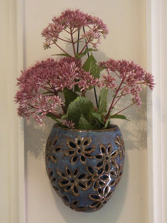 Hanging double walled blue pottery vase with hand carved daisies, wall pocket