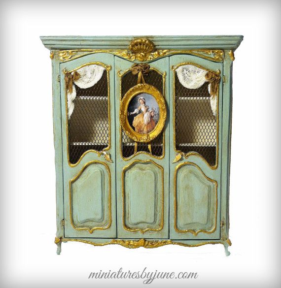 June Clinkscales - handmade and stained French Provincial armoire. The finish is aged verde.