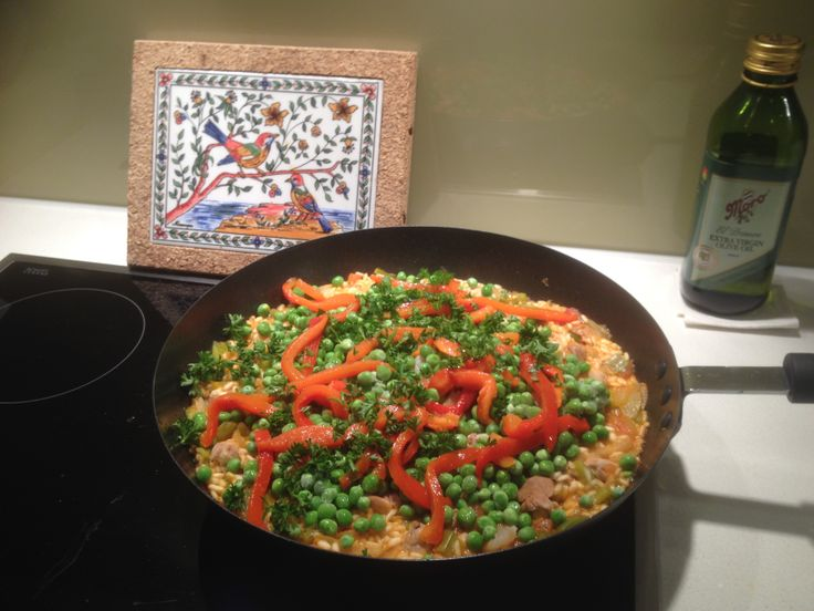 """Paella:   """"Traditionally, paella is made on a Sunday and because women need a day off from cooking it is usually made by the men.""""  (Full recipe on SBS website.)"""