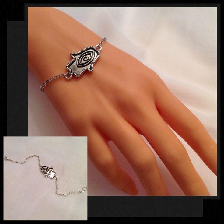 A personal favorite from my Etsy shop https://www.etsy.com/listing/231697509/antique-silver-hamsa-hand-braceletsilver