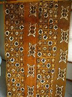 """BOGOLAN CLOTH - There are several mud cloth in West Africa.  The most prominent is said to have originated with the women of Mali where it is called Bogolan cloth or Bogolanfini (a composite of bogo, meaning """"earth"""" or """"mud""""; lan, meaning """"with"""" or """"by means of""""; and fini, meaning """"cloth"""".)  One center of high quality Bogolanfini production is the town of San, so it is sometimes referred to as San Cloth."""