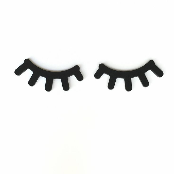 """Bring your modern nursery alive with these European style sleepy eyes wall decor. Each eye lash set comes in a pair in either black, mint, or pink. They measure 7""""x 3"""" and are made from solid MDF wood"""