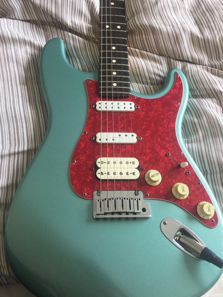 So I have this California strat that I bought from a second hand guitar shop and I'm a bit confused by it. It has these weird Seymour Duncan pickups and the serial number when tested it around 1998-200. I've never seen this colour with this scratch plate. Any info is helpful