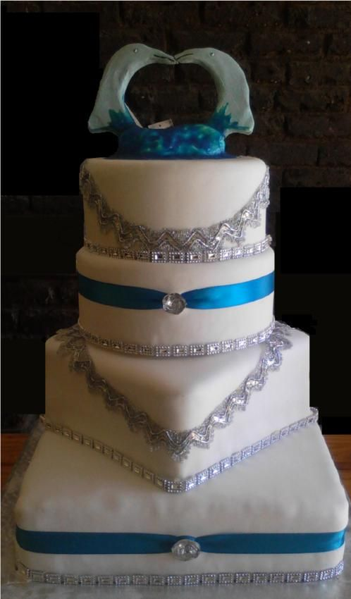 4 Tier, Dolphin topped wedding cake, with lace and gems - Wedding cake by Fairyfield cakes Krugersdorp fairfield@live.co.za 0839427354