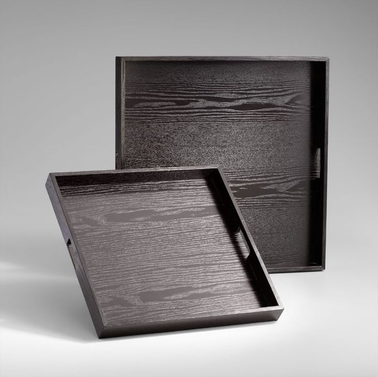 James Wood Trays: Sophisticated and versatile. Finely crafted of hardwood with a black limed finish, the James Trays are perfect for displaying books, choice accessories and decorative objects on your tabletop. Layer your coffee table or ottoman for a living room focal point. Or add candles or vases for a dining table centerpiece. The finely crafted, clean lines of the James Wood Trays are sure to lend sophisticated style to your contemporary home or office. $182.50