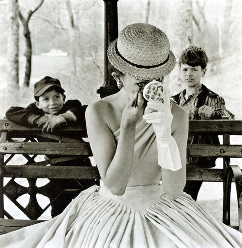 A model applying makeup in Central Park, New York City, 1955. Photo by Frank Paulin.