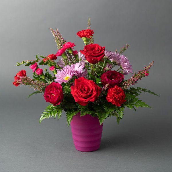 Romantic Floral Arrangement Of Red Roses Hot Pink Garden Roses