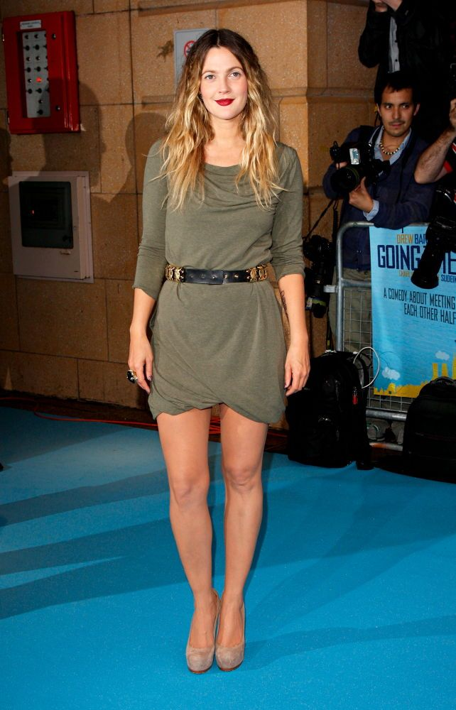 Drew Barrymore shows off her pins in this gorgeous Alexander McQueen dress at the Going the Distance premiere, London