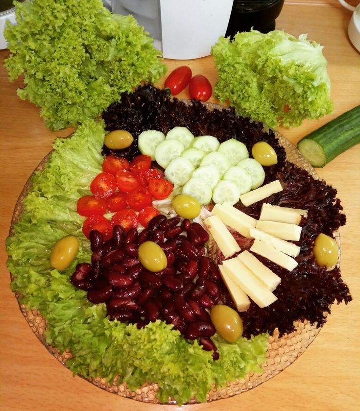 Yummy salad with green and red lola lettuce, cherry tomatoes, cucumber, red beans, olives  and smoked cheese 😋