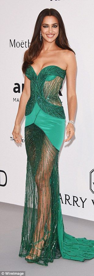 Green with envy? Model Irina Shayk divided opinion in her emerald coloured gown by Atelier Versace that included several patches of very sheer fabric, as well as a figure-hugging bustier-style top and satin panels