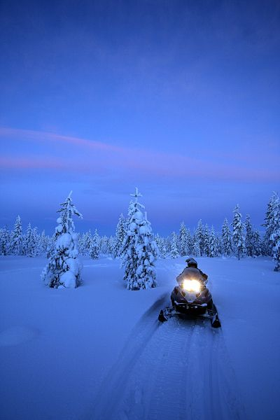 Take a night time snowmobile excursion to a vantage point in the hope of seeing the magical Northern Lights