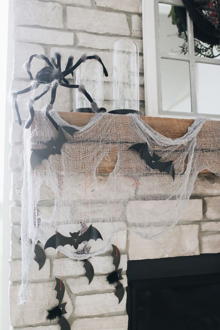 I love the bats in this epic spooky fireplace decoration post by @ninaandcecilia @worldmarket #worldmarket #ad #WMHalloween