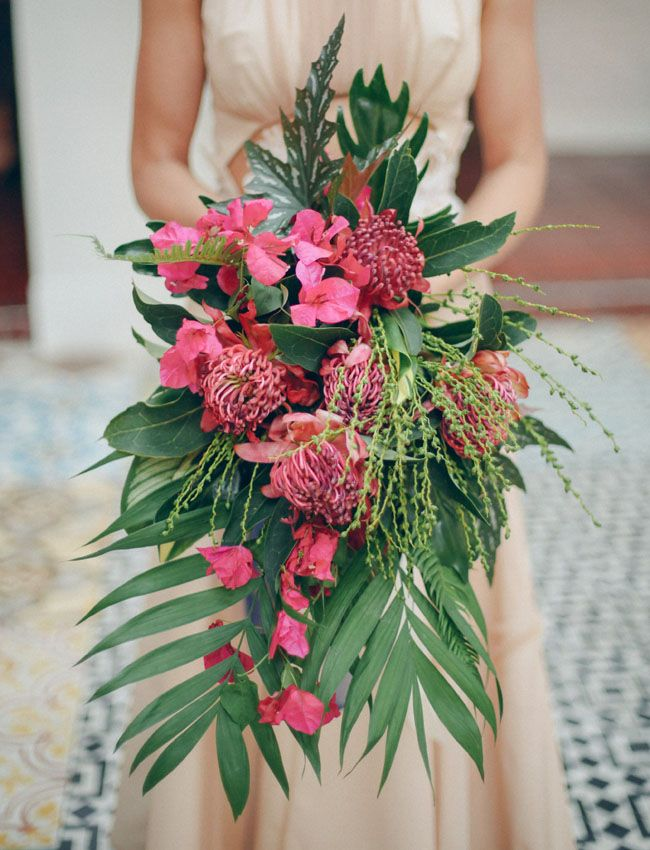 Love the tropical feel of this cascading wedding bouquet.