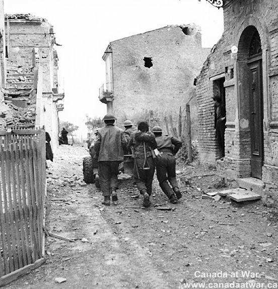 Ortona - Canadian troops moving anti-tank gun into position during street fighting in Ortona, 21 December 1943.