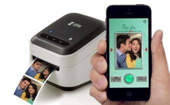 I really enjoyed playing with this little printer & the Zink App last year! (...or was it the year before?) I would go with this $199 ZINK hAppy Smart App Printer™ | ZINK®, and then you can use your larger iPad screen to design on.